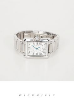 Miamasvin Silver Tone WristwatchSilver tone wristwatch. Best paired with a boat neck black dress plus red leather pumps.- Metal chain strap- Clip on closure- Color: Silver