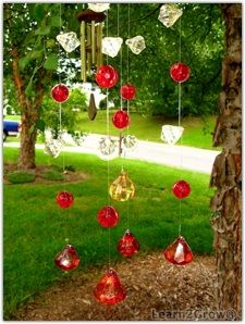 "Light mobiles for the garden or patio. Use beads or crystals & 1 inch craft mirrors. ""With or without mirrors, a light mobile beautifully reflects sun or candle light in the garden."""