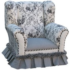 A lovely addition to your little one's bedroom, this charming arm chair showcases a wingback silhouette with floral upholstery and a gingham skirt.
