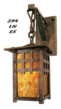 """294-LN-ES J Morgan Single Lantern Arts & Crafts Sconce Arts & Crafts, Craftsman, and Mission Style  Lights Inspired by the classic hammered style of pure arts & crafts, this fixture is heavily cast, not inexpensive sheet metal. The shades are real mica panes. Not just an """"Arts & Crafts Style"""" fixture, but each one a hand-finished true work of art."""