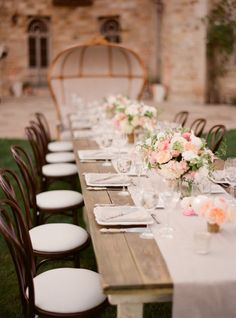 long wooden tables, cream runners, pinkish centerpieces