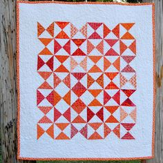 Orange Hourglass Baby Quilt - READY TO SHIP. $78.00, via Etsy.