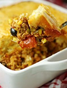 Tamale Pie Casserole ~ spicy ground turkey & vegetable filling topped with a thick layer of golden cornbread. Just perfect for your Cinco de...