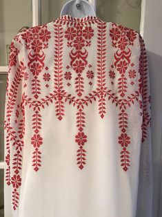 Short White / Ivory dress and cape with Red Embroidery / crossShort white dress and cape with red Embroidery / cross stitch. The dress is also available in Navy blue and purple The embroidery on the dress is machine stitched Embroidery On Kurtis, Kurti Embroidery Design, Hand Embroidery Dress, Bead Embroidery Patterns, Couture Embroidery, Embroidery Suits, Hand Embroidery Designs, Beaded Embroidery, Cross Stitch Embroidery