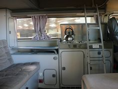 We need to get a ladder for the kiddos to get up into the loft...I think gowesty.com sells them - Interior of one of the campervans on display | Flickr - Photo Sharing!