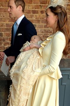 This is a really great picture of Kate's outfit - Kate and Prince George leaving the christening service. - Kate's in an Alexander McQueen Ivory Wave Ruffle Jacket and Jane Taylor hat for Prince George's christening. - 10/23/2013