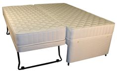 "Hilton Pocket Luxury Overnighter Guest Bed - £599.95 - A standard 3ft bed, but with the advantage of another bed (2ft6""W x 5ft9""L) bed underneath that rolls out and lifts up for an occasional larger bed or another small single for the unexpected visitor. The top mattress, Hand nested individual pocket springs in a medium/firm tension and being pocket sprung it is a true ""no roll together"" mattress.  The Hilton Pocket Luxury Mattress has deep layers of soft upholstery which is then hand…"