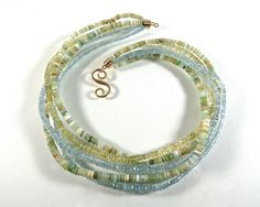 Beautiful Aquamarines, Heliodore, and Peruvian Opal beads in this lovely 18 kt. yellow gold torsade style necklace