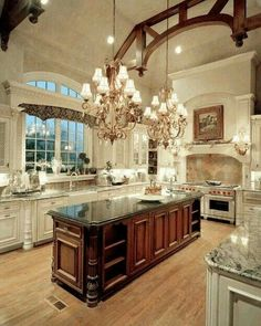 Really like the mix of finishes, various cab fronts & counter tops,  the ceiling arch, the cook top/venthood mantel, the arched window over sink. Like the trim bridging the sink window as it creates more interest for the window while anchoring the surrounding cabs. Love the finish on the chandeliers.