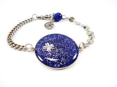 Colorama Trends- Bracelet with blue fabric and glitters. Clover inside...