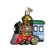 Locomotives are associated with Christmas, since that is when many children are first introduced to toy trains. Who can forget the excitement of Christmas morning and discovering a speeding locomotive pulling its cars beneath the family Christmas tree or winding through a toy village? #trainday #locomotive #toytrain #choochoo #christmasmorning #glassornament #oldworldchristmas Small Locomotive (Item #46003) Bestseller!