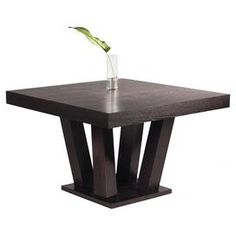 """Square dining table with a branching base.   Product: Dining tableConstruction Material: Ash and ash veneerColor: Dark espressoFeatures: Seats up to fourDimensions: 30"""" H x 47"""" W x 47"""" D"""