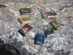 Another one that I want!  WarriorsCats Books Charm Bracelet by sophiesbeads on Etsy. $21.99 USD, via Etsy.