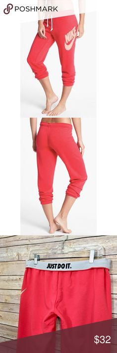 """Nike Rally Capri Sweatpants in Fusion Red The famous logo emblazons one hip of lean capri sweatpants that are garment washed for incredible softness, and a look and feel that would normally take years of wear to achieve. Approx. Measurements: 24"""" inseam; 12"""" leg opening; 9 1/2"""" front rise; 14"""" back rise. Elastic/drawstring waist. Cropped. 80% cotton, 20% polyester; machine wash cold, tumble dry low. In great condition. Only worn twice. No trades, please! Offers welcome. Nike Pants Track…"""