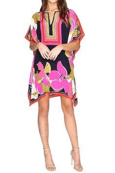 Our best-selling and beloved Theodora Dress is looking alive with the Aloha spirit. Featuring our Hawaiian inspired placed Lehua floral print and a colorblocked border trim this 100% Silk Crepe de Chine caftan is effortless easy and elegant for sunny weather.Elevate your look with this Trina Turk Theodora Dress.  Luxe silk fabrication. Oversized silhouette. Vibrant print is featured all throughout. Notched V-neckline. Short flutter sleeves. Handkerchief hemline. Unlined. 100% silk. Dry clean…