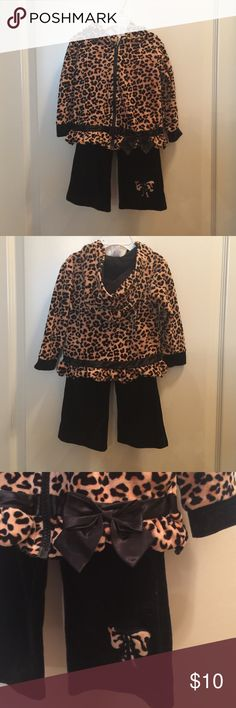 Toddler velour sweatsuit Precious velour sweatsuit with a cheetah print hooded jacket that zips up the front...black velour pants with cheetah print bow on leg....very warm and comfy....gently used! Starting Out Matching Sets