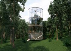A mature fir tree is enclosed at the centre of this house by Aibek Almassov, which is completely glazed and cylindrical giving views of its forest setting