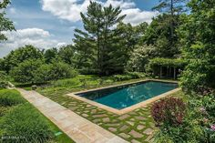 This Greenwich, Connecticut home's backyard has a tidy, neat pool with its own house to match.