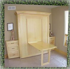 Murphy bed and table...great idea for a guest room or office.