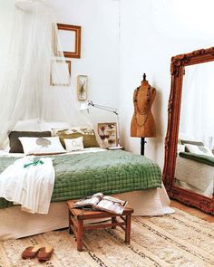 For the bedroom - layers of quilted bedding look inviting. Details: vintage mannequin; gilt frames; fresh green & white with gold accents.