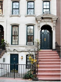 Cute city townhouse entrance.  Red steps.  Ornate doorway.