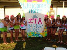 such a cute bid day banner! Zeta Tau Alpha. Love the tucker hat/neon tank outfit