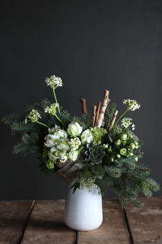 Like a walk through high alpine forests, this piece embraces the simplicity of nature: 'Woodland Silver' by Winston Flowers. flowers and bouquets