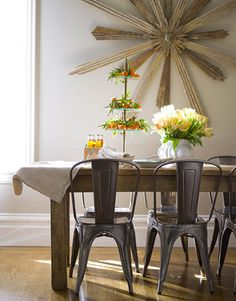 I'm always a fan of a rustic farmhouse table and french metal chairs. Rustic, but very contemporary