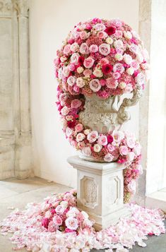 gorgeous floral overload /// #flowers #roses #pedestal #pink #red #wedding #party #romantic
