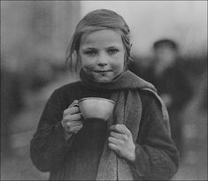 A young girl enjoys a cup of tea courtesy of the advancing Allied armies in a sector of Europe now cleared of Hitler's troops. 1944.