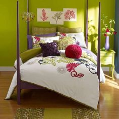 Love it! Great color and pattern combination! green bedroom with flower bedspread