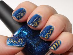 Blue with golden designs nails
