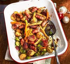 Contains pork – recipe is for non-Muslims only Enjoy the best of Christmas in a traybake. A perfect Boxing Day feast for using up leftovers like potatoes, parsnips, carrots, sprouts and pigs-in-blankets Tray Bake Recipes, Dinner Recipes, Bbc Good Food Recipes, Cooking Recipes, Vegetarian Recipes, Yummy Food, Tasty, Boxing Day Food, Christmas Dinner Menu