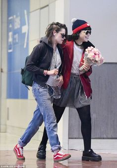 Kristen Stewart greeted with flowers at the airport by rumoured girlfriend SoKo | Daily Mail Online
