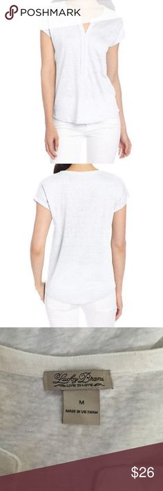 """Lucky Brand Sz M April Pleated Placket Linen Top Lucky Brand April Pleated Placket Linen Top Size M Condition: NWOT Color: Off White/Cream Front placket Short sleeves Rounded hem Semi-sheer 100% linen Slub knit Raw edge placket Approx. measurements: Chest (armpit to armpit) - 21"""" Length (shoulder to hem) - 24"""" Lucky Brand Tops Blouses"""