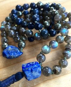 Lovely combination of Raw Lapis at marker #54 and Guru, Labradorite, Dumortierite and Pyrite Mala Beads, hand knotted with khaki thread, finished with a raw Lapis Lazuli Guru Bead and a soft pima cotton tassel. Root Chakra, Third Eye Chakra, Crown Chakra Japa Mala. Yoga Jewelry,