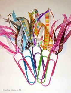 Make your own Cute Bookmarks! Just double the ribbon over the paper clip using the same method described here (in making a hula skirt: http://www.budget101.com/crafts-scrapbooking-ideas/how-make-hula-skirt-3816.html )