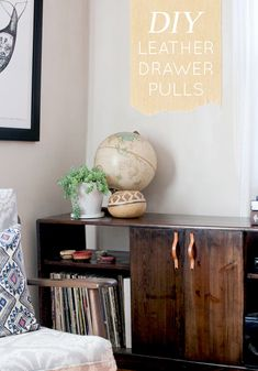 DIY Project: Leather Drawer Pulls - Design*Sponge.  Something like this would also work for hiding Roo's box...