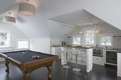 A kitchenette with island is handy in a bonus room that is far from the home's kitchen.