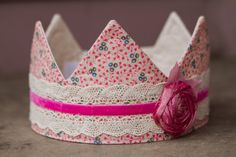This will fit most toddlers and children.    All my crowns are one of a kind so you can be assured no other photographers have this crown.    All of my crowns are also sewn on the edges and will not fray. I also reinforce them all with stitching so the fabric will not separate. These crowns are made to last and be played with.