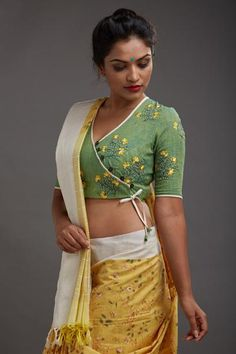 This summery yellow and off white saree is handmade with a unique weaving process - the threads of the body and the border are woven with separate weft shutt...