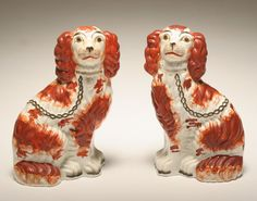 Pair painted porcelain Staffordshire spaniel dog figures. Ripley Auctions, $150