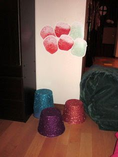 buckets from dollar tree painted and glittered to look like gumdrops