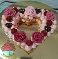 Cake made with 2 latere of cookie, filled with raspberry smbc and topped with fresh raspberry, Chocolate hearts and fondant roses.