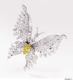 Bulgari-designed diamond butterfly brooch features a Marquise-shaped diamond of fancy deep orangy yellow color weighing approximately 2.56 carats. Its estimate is $50,000 to $70,000.