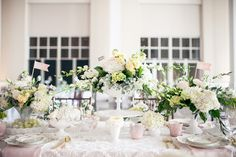 The NotWedding Athens Bridal Party table of milk glass compotes spilling with garden roses, stock and orchids, oh my. Holland Daze/ florals  I Do Linens/ linen Liddabits/paper Southern Vintage/ rentals