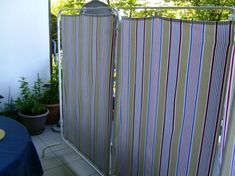 Quick and cheap screens for outdoor or indoor, use ikea Mullig clothes rack + curtainrings and fabric