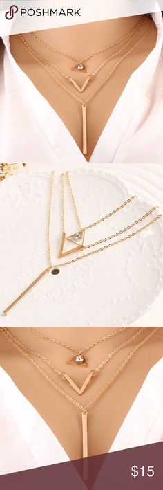 """Gold Multi-layer Chevron & Bar Necklace New in package Gold Tone Multi-layer Chevron & Bar Necklace. Material: Alloy metals, simulated crystal.  Bar length: 3.2 cm. Chain length: 60 cm.                                                          ❌trades  ❌ lowball offers  ✅ use the """"ADD TO BUNDLE"""" link below to get 15% discount on 2+ items ✅  Posh Rules   Boutique Jewelry Necklaces"""