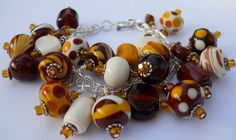 Love this colors! Charm Bracelet - Natural and Brown Colored Lampwork Beads by perlesdeverre via Esty