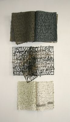 "Calligraphy done with paper pulp make up these sculptures by Miriam Londoño    ""The structure of these books intend to trigger meanings in the mind: what makes a book? Is it the words or the pages, or both? Seen as a sieve of ideas, the books stop being page-by page compilations, to be transformed into fragile nets catching language's essentials metaphors."""